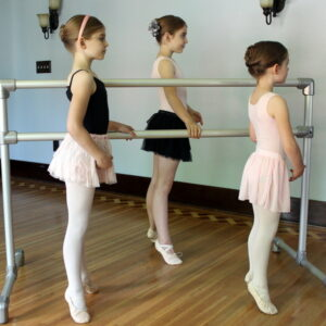 Young ballet dancers working on homemade barre.