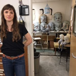 Johanna Winters posing with puppet heads