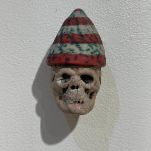 "S-44  |  Tom Bartel, ""Small Skull (red party hat)"" (2018)"