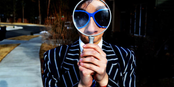Posing with a magnifying glass