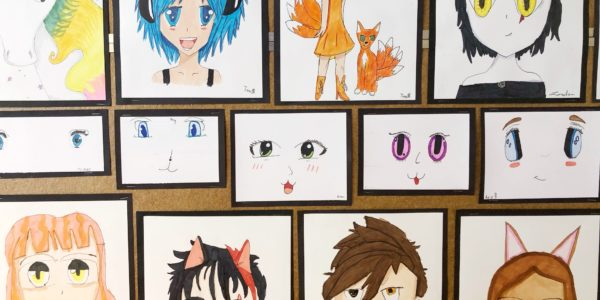 Anime artwork created by students displayed on a wall