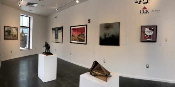 2D and 3D art is hung on gallery walls and displayed on pedestals