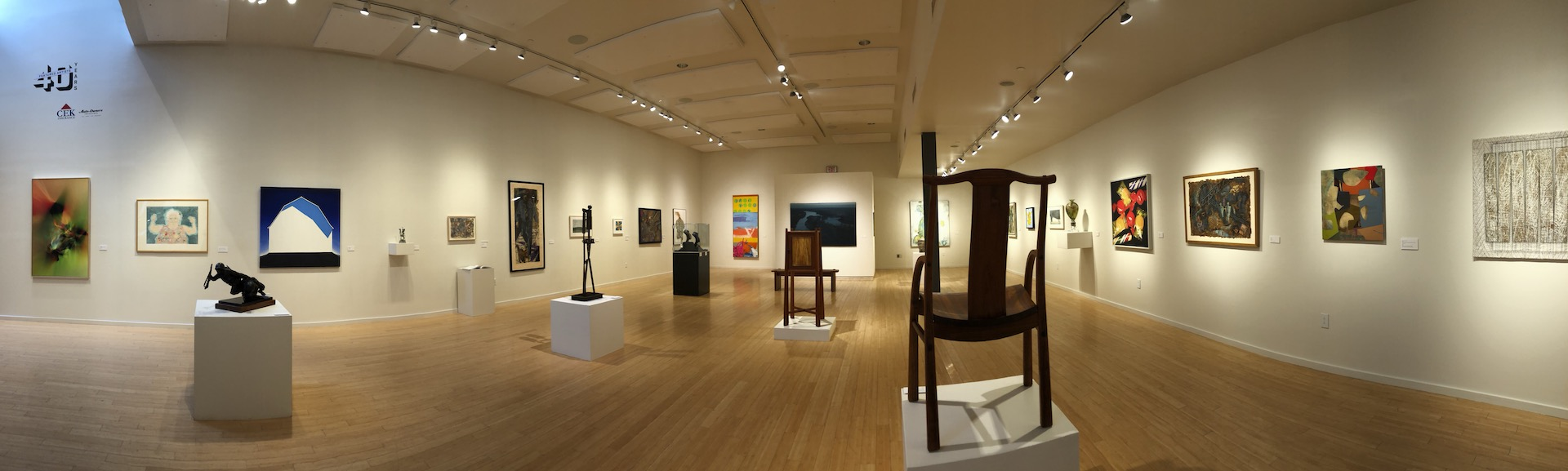 A panoramic shot of a large gallery with numerous 2D & 3D pieces