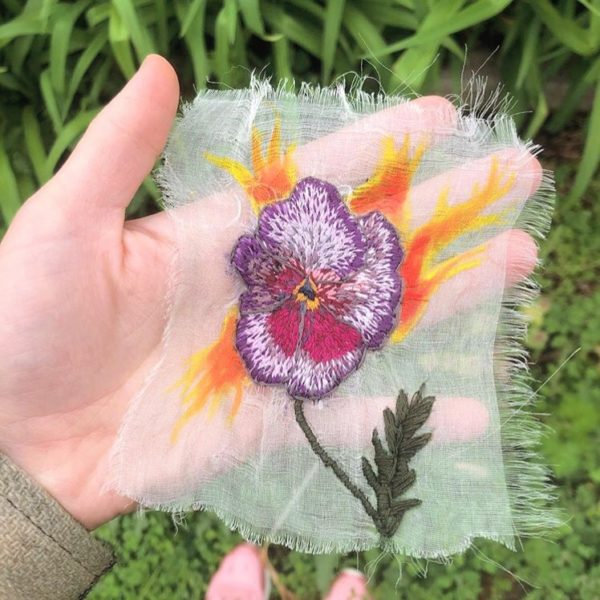 An example of experimental embroidery, a flower embroidered on sheer fabric