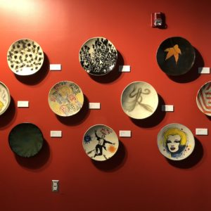 Ten Platters Hang on a Red Wall
