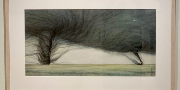 Framed ink drawing of two tornadoes in a field.