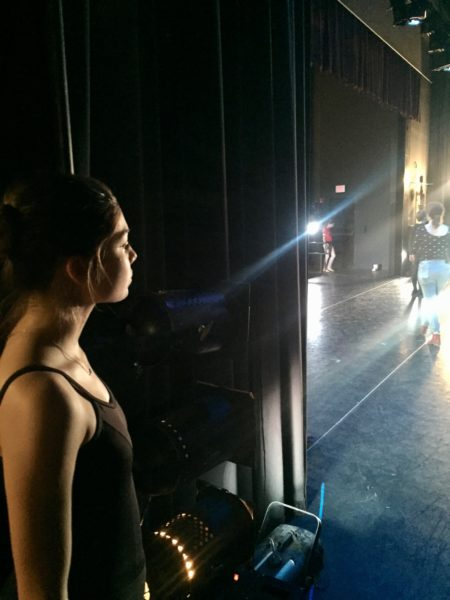 Dancer Audrey Senger looks at the empty lighted stage.