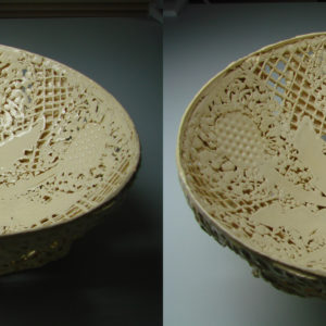 A ceramic bowl featuring dandelions and lattice cutouts.