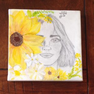 A pencil sketch of a woman whose face is partially covered by painted yellow sunflowers.