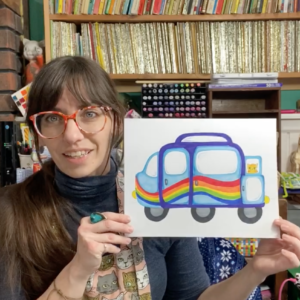 A woman holds an ink drawing of a van featuring a rainbow and a cat.