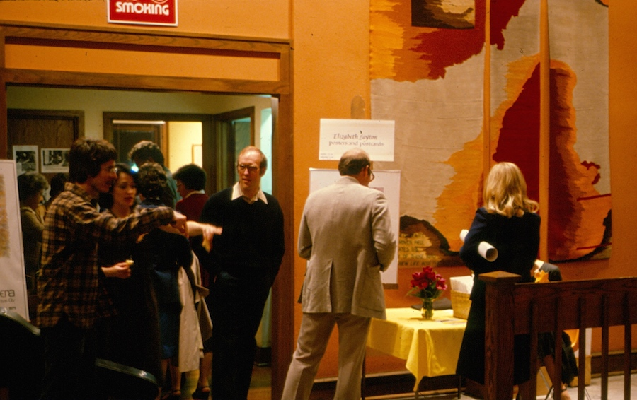 Vintage photo of people entering a gallery show.