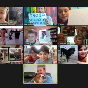 Children in a zoom meeting hold up photos of animals up for adoption.
