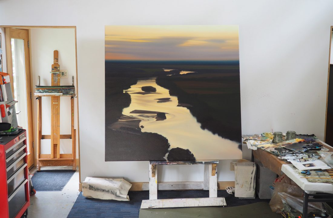 A painting sits on an easel.